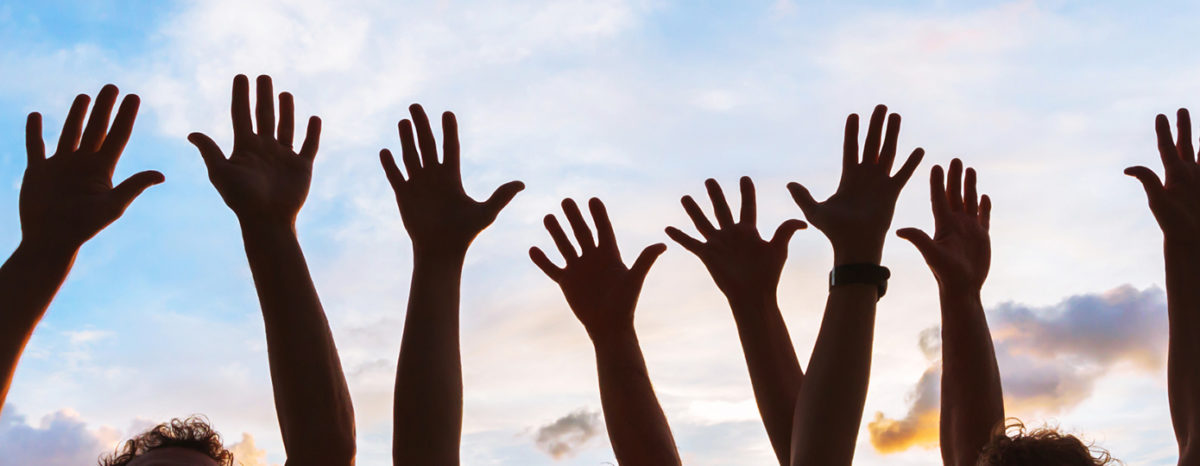 raised hands against the sky